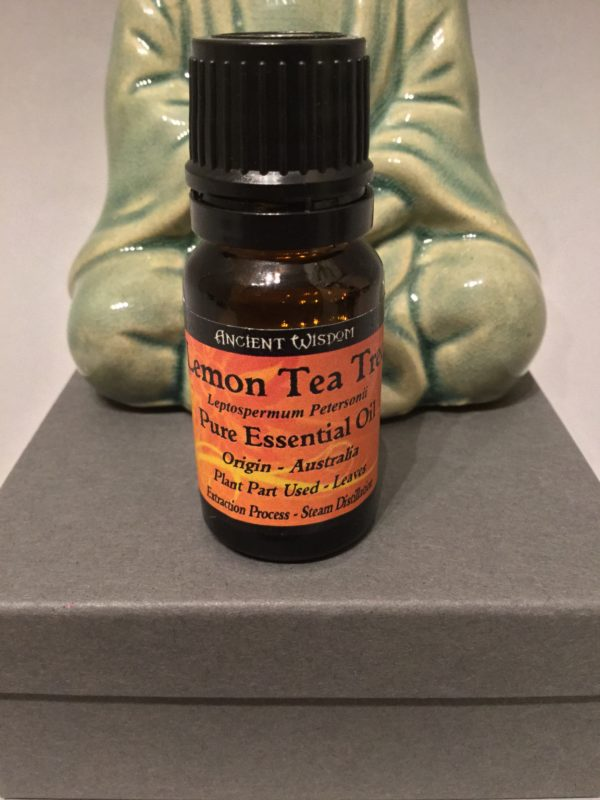 Bottle of Essential Oil: Original Lemon Tea Tree Scent