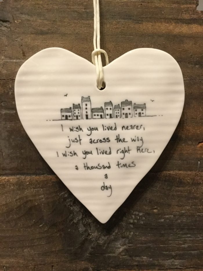 East Of India: White Porcelain Hanging Heart Sign with Black Writing. Saying: I Wish You Lived Nearer. Village Image