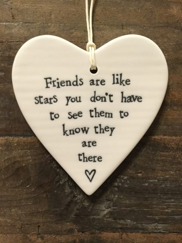 East Of India: White Porcelain Hanging Heart Sign with Black Writing. Saying: Friends Are Like