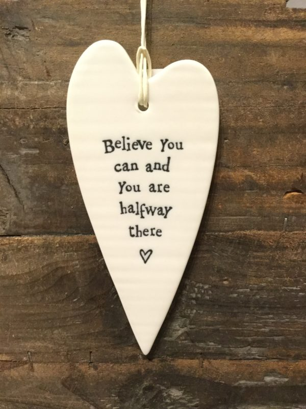 East Of India: White Porcelain Long Hanging Heart Sign with Black Writing. Saying Believe You Can