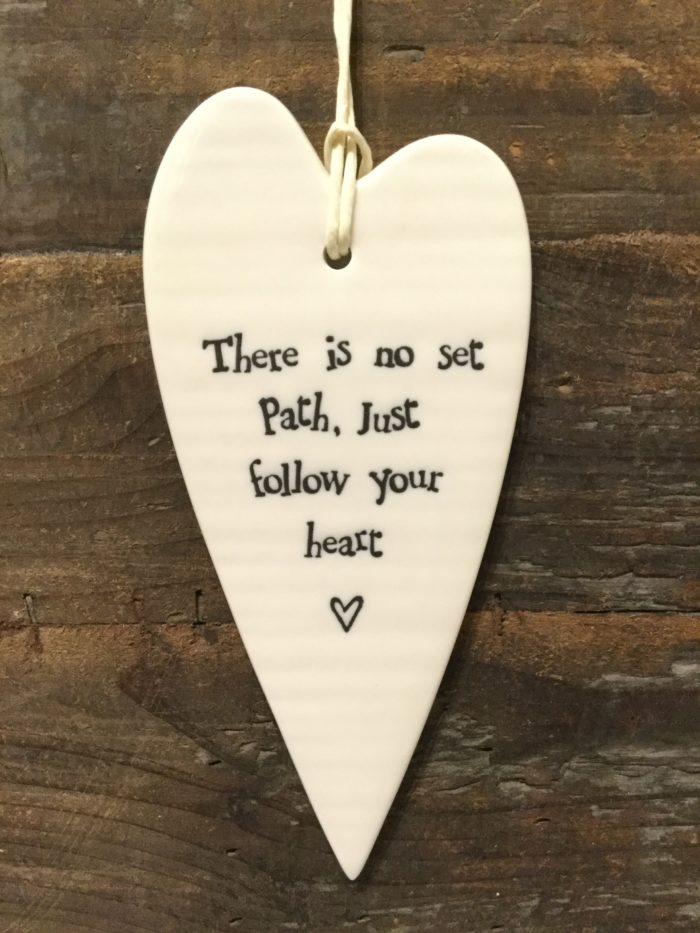 East Of India: White Porcelain Long Hanging Heart Sign with Black Writing. Saying: There is No Set Path