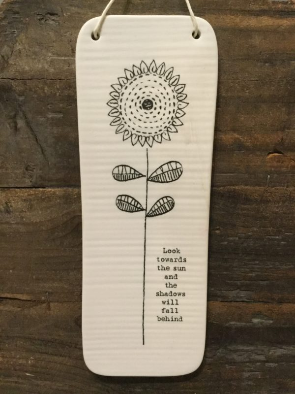 East Of India: Long White Porcelain Rectangular Sign with Black Writing. Saying: Look Towards The Sun. Flower Image