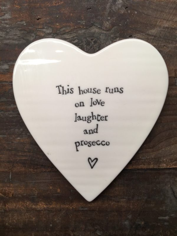 East Of India: White Porcelain Coaster with Black Writing. Saying: This House Runs on Prosecco