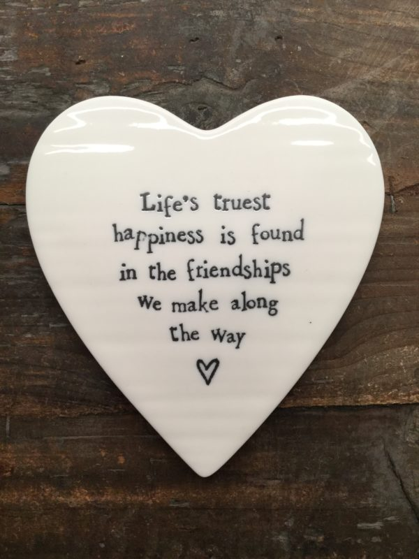 East Of India: White Porcelain Coaster with Black Writing. Saying: Life's truest