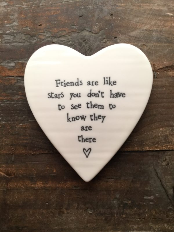 East Of India: White Porcelain Heart Coaster with Black Writing. Saying: Friends Are Like Stars