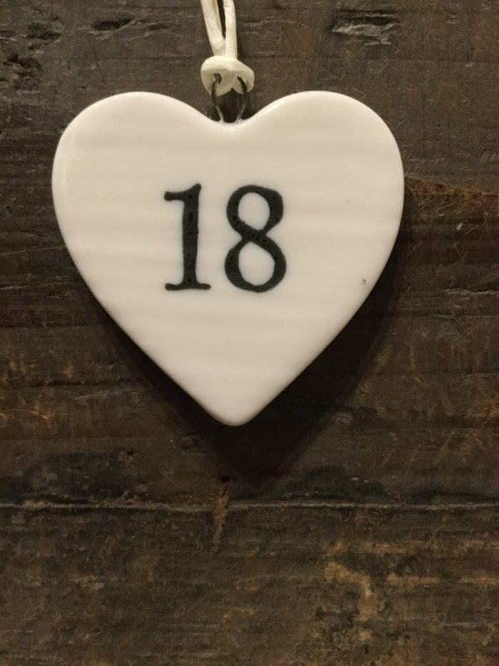 East Of India: Small White Porcelain Hanging Heart with Birthday Number in Black Writing: 18