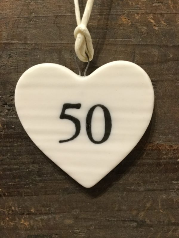 East Of India: Small White Porcelain Hanging Heart with Birthday Number in Black Writing: 50