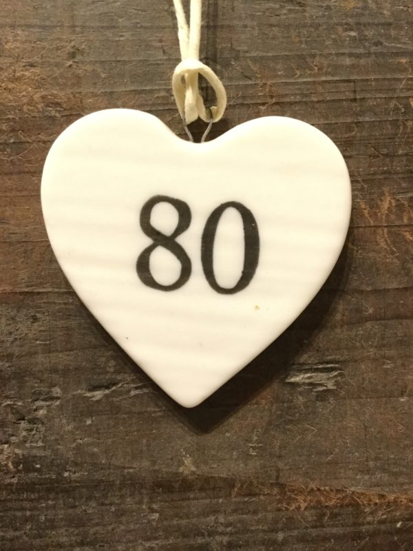 East Of India: Small White Porcelain Hanging Heart with Birthday Number in Black Writing: 80