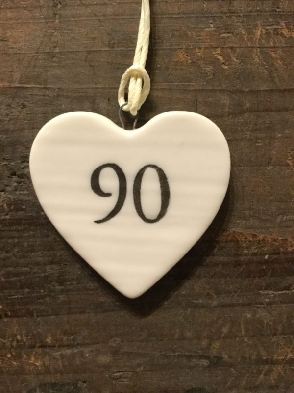 East Of India: Small White Porcelain Hanging Heart with Birthday Number in Black Writing: 90