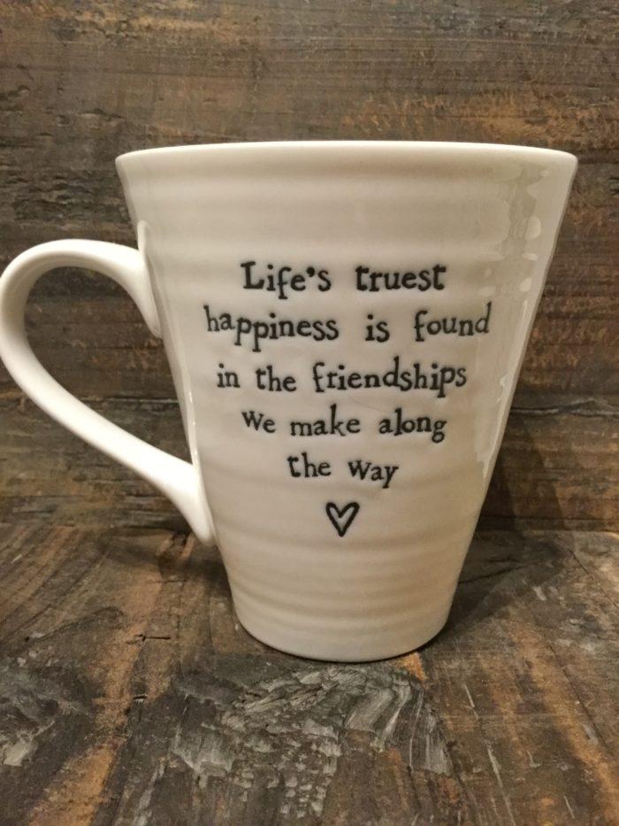 East Of India: White Porcelain Mug. Saying: Life's Truest Happiness