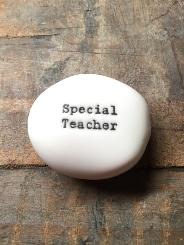 East Of India Small White Porcelain Pebble with Black Type Engraved. Saying: Special Teacher