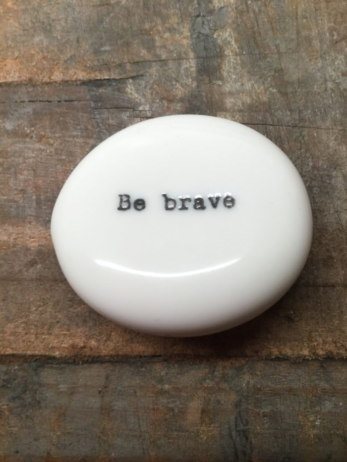 East Of India Small White Porcelain Pebble with Black Type Engraved. Saying: Be Brave