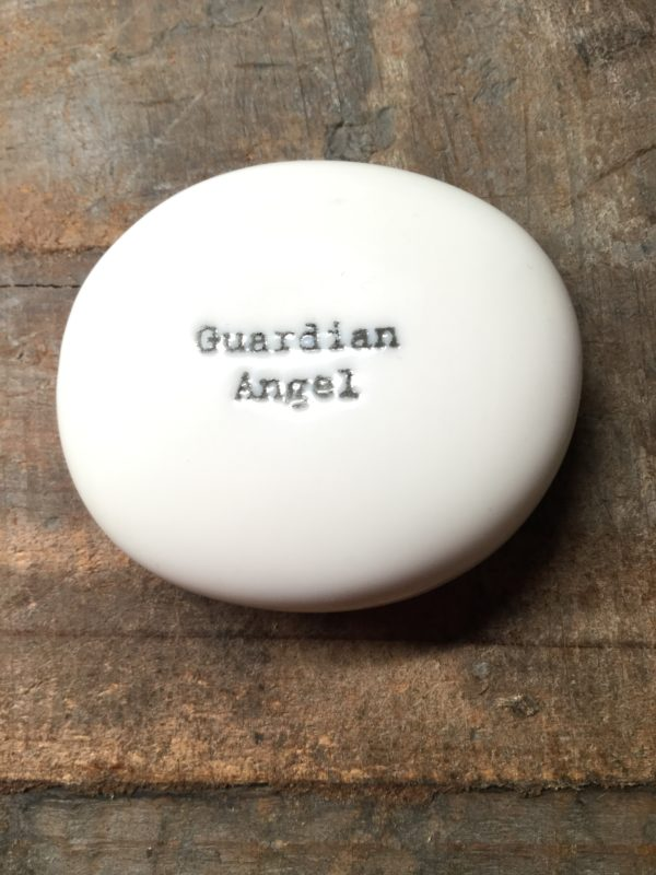 East Of India Small White Porcelain Pebble with Black Type Engraved. Saying: Guardian Angel