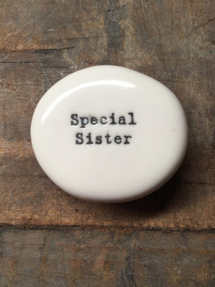 East Of India Small White Porcelain Pebble with Black Type Engraved. Saying: Special Sister