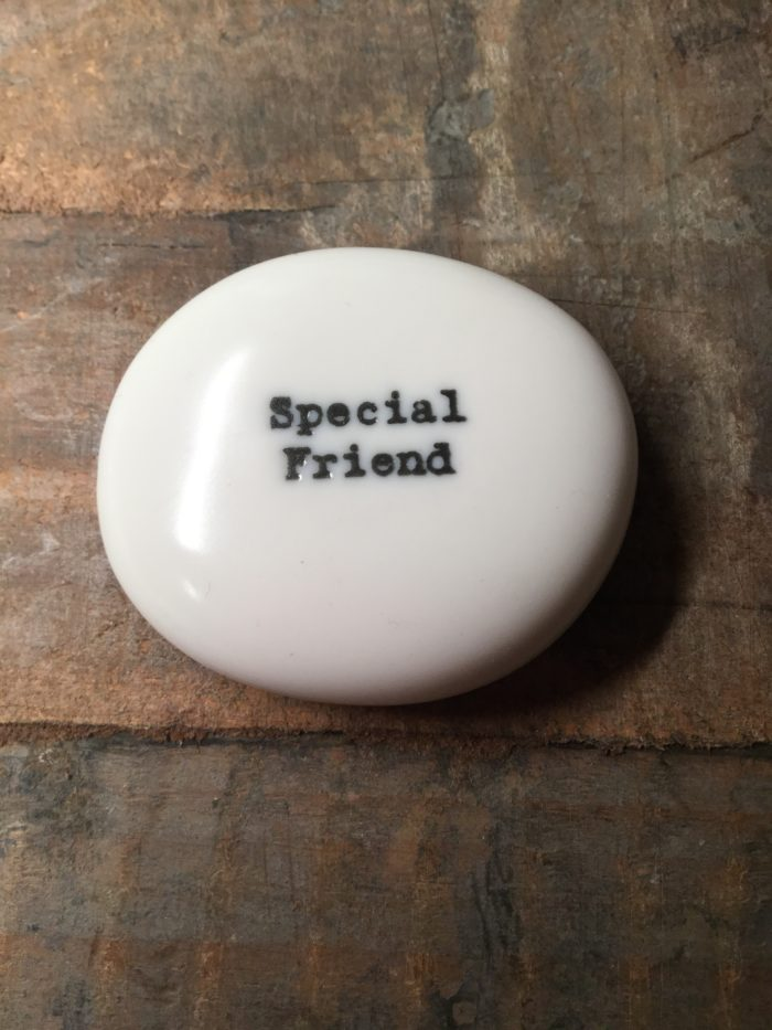 East Of India Small White Porcelain Pebble with Black Type Engraved. Saying: Special Friend