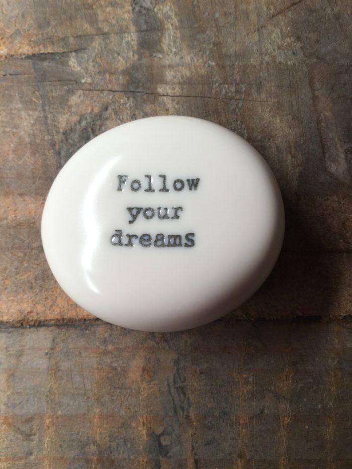East Of India Small White Porcelain Pebble with Black Type Engraved. Saying: Follow Your Dreams