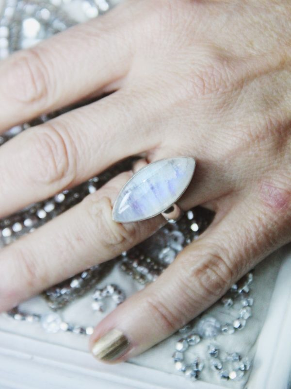Rainbow moonstone silver ring in pointed oval shape.