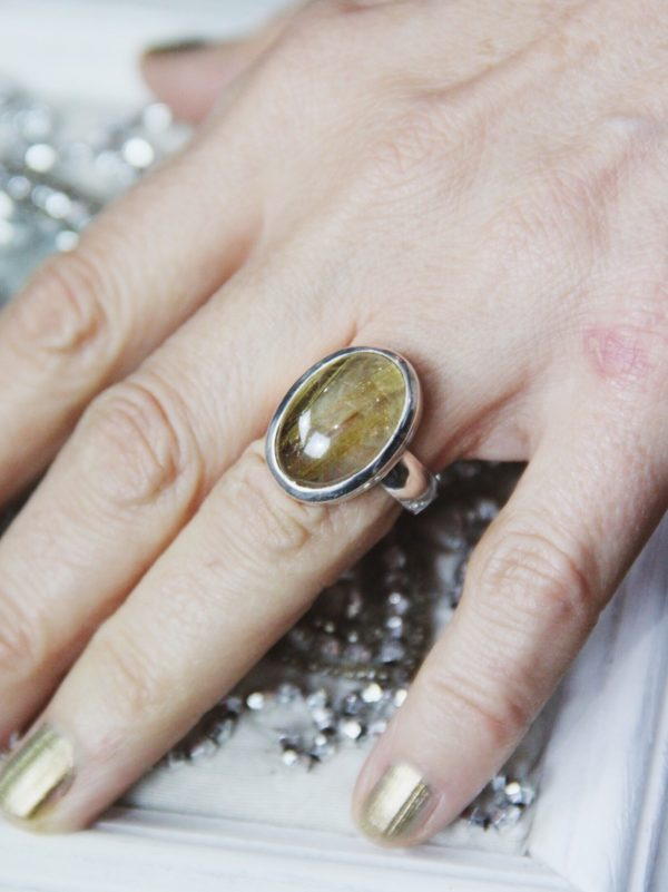Rutilated Quartz sterling silver ring in oval shape.