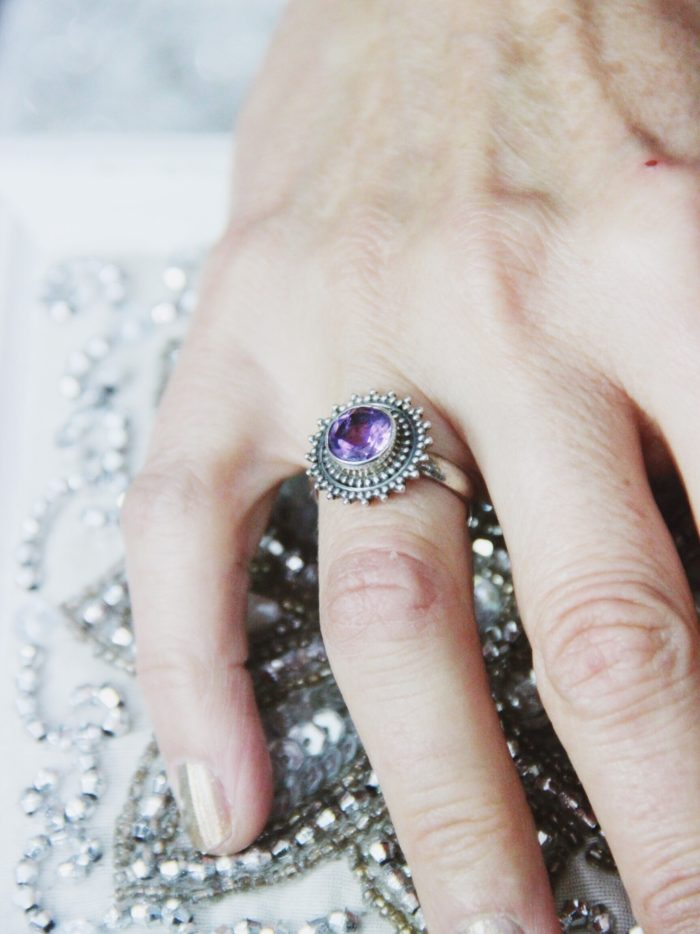 Amethyst_Sterling_Silver_Ring with flower pattern arounf the stone.