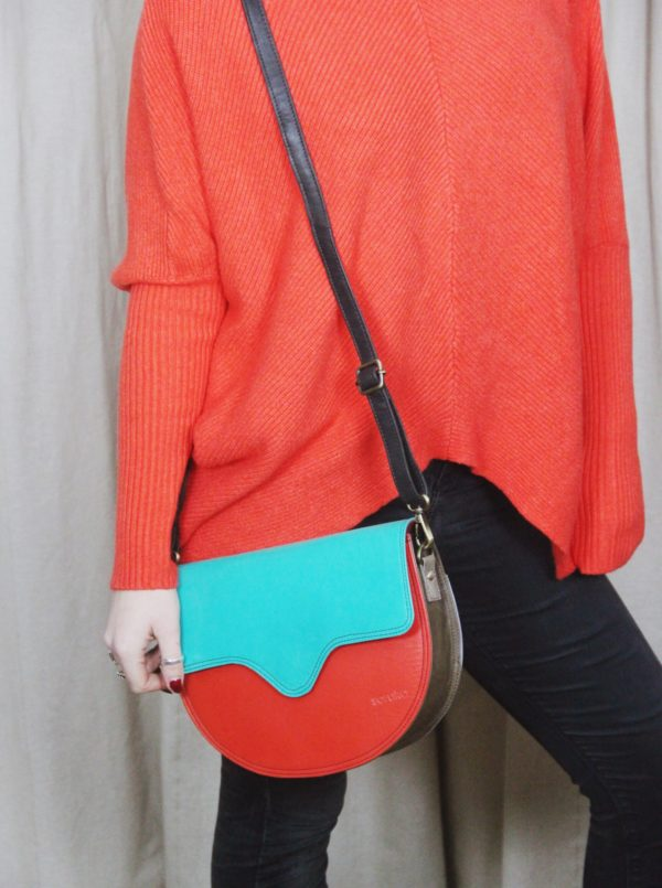 Bright orange ribbed, crew neck jumper with turquoise and orange recycled leather bag and Biscuit Beret