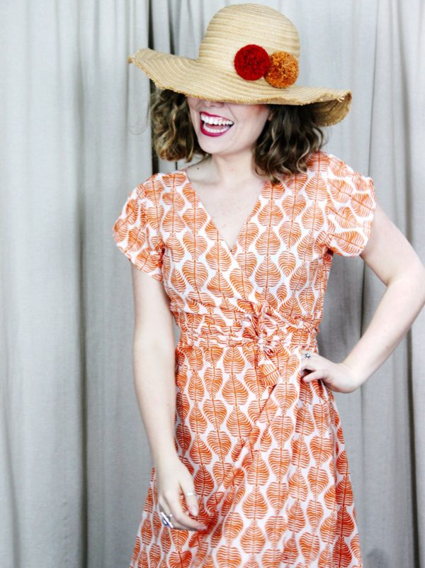 Anita_Leaf_Wrap_Dress_Orange_Lara_Pom_Pom_Hat